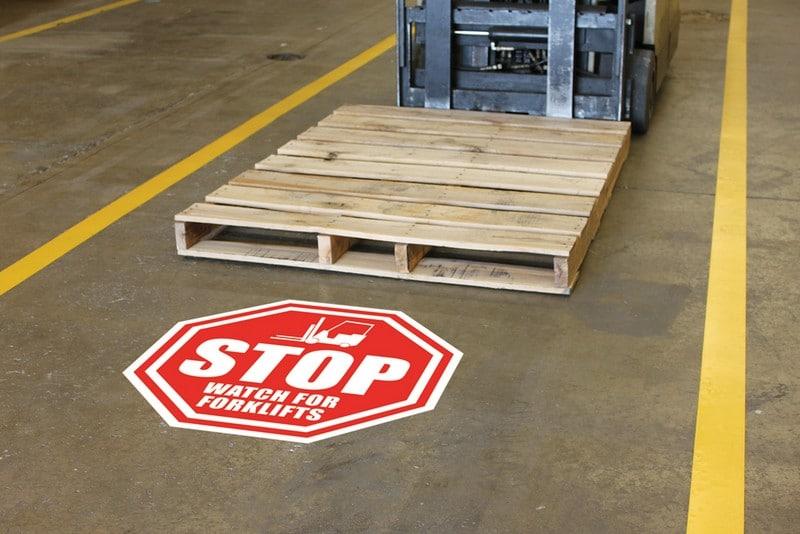Señales adhesivas para suelos industriales.