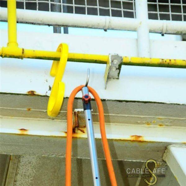 Pértiga para colgar cables 2